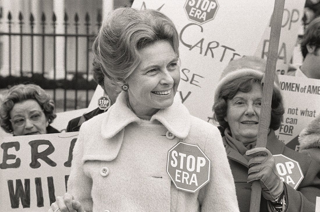 Conservative activist Phyllis Schlafly wearing a ''Stop ERA' ' badge demonstrating with other women against the Equal Ri ghts Amendment in front of the White House Washington D.C.  Feb. 4 1977.                                                Feb. 4 1977.                                                Feb. 4 1977.