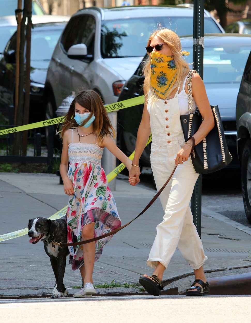 Sienna Miller and her daughter Marlowe walk their dogs while braving the NYC heatwave in Manhattan's West Village area.  At one point one of her dogs started sniffing Sienna's foot. **SPECIAL INSTRUCTIONS*** Please pixelate children's faces before publication.***. 27 Jul 2020,Image: 547608255, License: Rights-managed, Restrictions: World Rights, Model Release: no, Credit line: LRNYC / MEGA / The Mega Agency / Profimedia