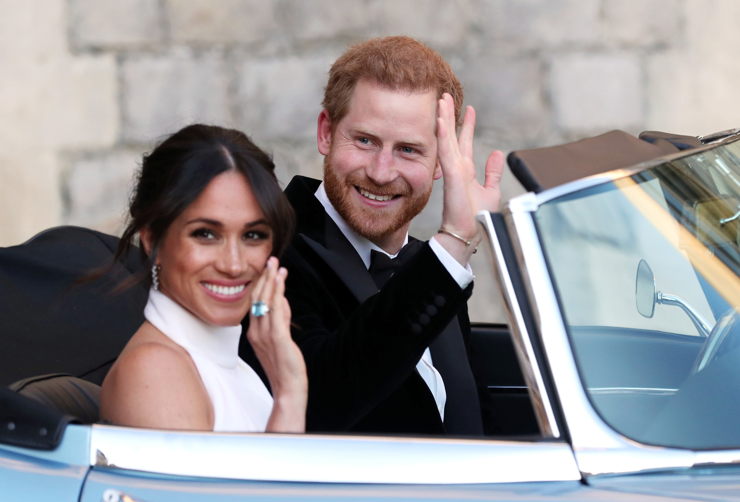 The newly married Duke and Duchess of Sussex, Meghan Markle and Prince Harry, leaving Windsor Castle after their wedding to attend an evening reception at Frogmore House The wedding of Prince Harry and Meghan Markle, Open-top car, Windsor, Berkshire, UK - 19 May 2018,Image: 491696088, License: Rights-managed, Restrictions: , Model Release: no, Credit line: - / Shutterstock Editorial / Profimedia