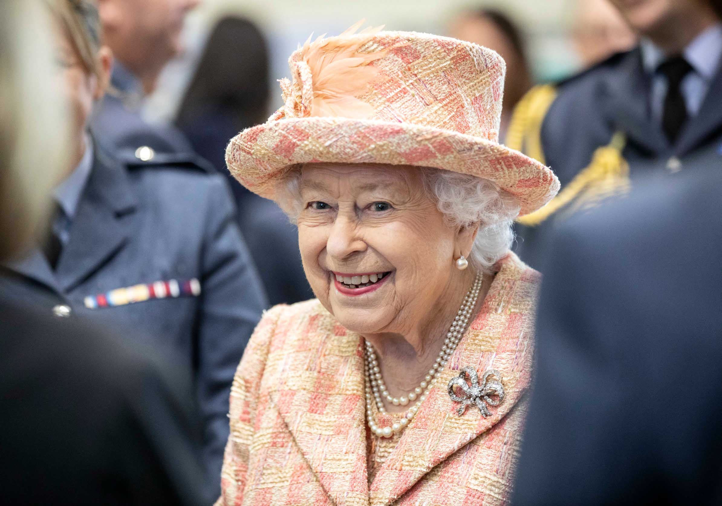 KING'S LYNN, ENGLAND - FEBRUARY 03: Queen Elizabeth II meets personnel at RAF Marham where she inspected the new integrated training centre that trains personnel on the maintenance of the new RAF F-35B Lightning II strike aircraft at Royal Air Force Marham on February 3, 2020 in King's Lynn, England. (Photo by Richard Pohle - WPA Pool/Getty Images)