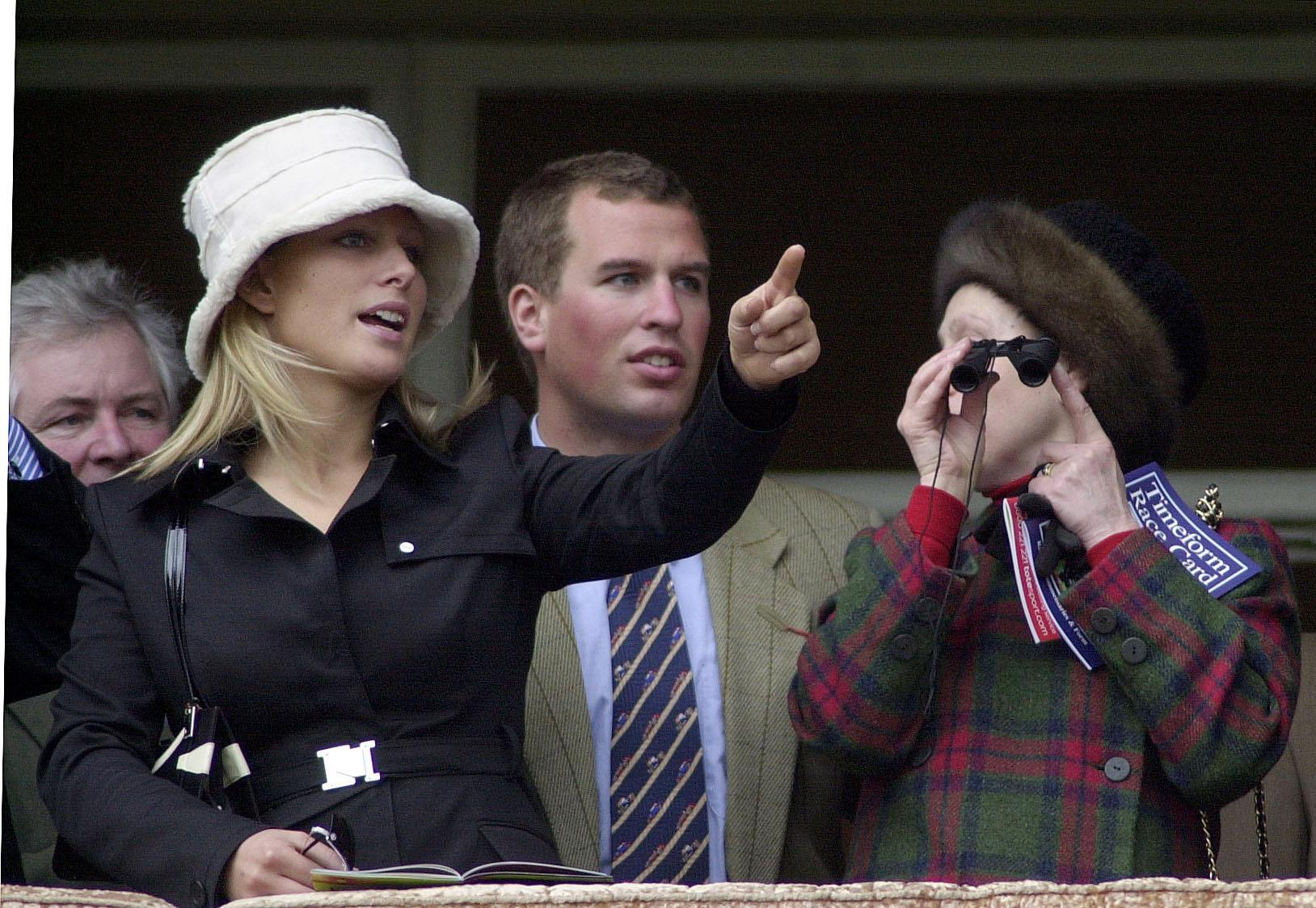 File photo dated 18/03/04 of the Princess Royal (right) with her children Zara and Peter Phillips at Cheltenham Race Course. Anne celebrates her 70th birthday on Saturday.,Image: 551795853, License: Rights-managed, Restrictions: FILE PHOTO, Model Release: no, Credit line: David Jones / PA Images / Profimedia