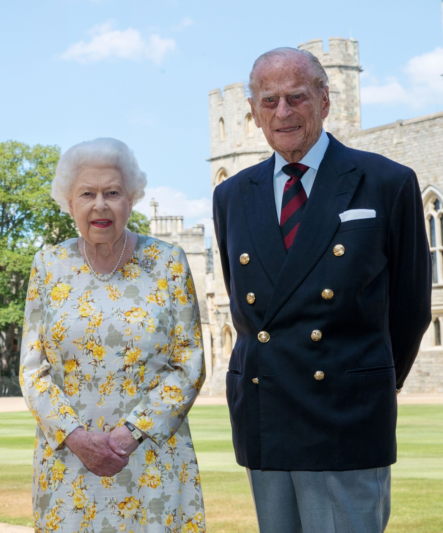 Queen Elizabeth II and the Duke of Edinburgh in the quadrangle at Windsor Castle, in a new photograph released to celebrate the Duke's  99th Birthday. The Queen is wearing an Angela Kelly dress with the Cullinan V diamond brooch. The Duke is wearing a Household Division tie. Picture: Pool / i-Images,Image: 529823829, License: Rights-managed, Restrictions: UK OUT.  End users shall not licence, sell, transmit, or otherwise distribute any photographs represented by eyevine, to any third party. Contact eyevine for more information: Tel: +44 (0) 20 8709 8709 Email: info@eyevine.com, Model Release: no, Credit line: i-Images / Eyevine / Profimedia