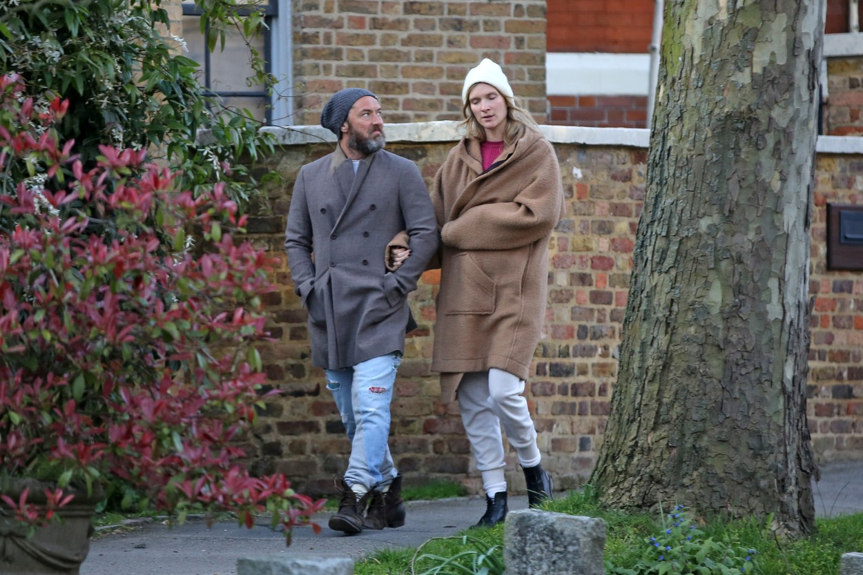 EXCLUSIVE: Bearded Jude Law, 47, goes arm in arm with wife Phillipa Coan, 32, as the couple emerge from home quarantine for a brisk walk in lockdown London. 30 Mar 2020,Image: 510735956, License: Rights-managed, Restrictions: NO Australia, Germany, New Zealand, United Kingdom, Model Release: no, Credit line: MEGA / The Mega Agency / Profimedia