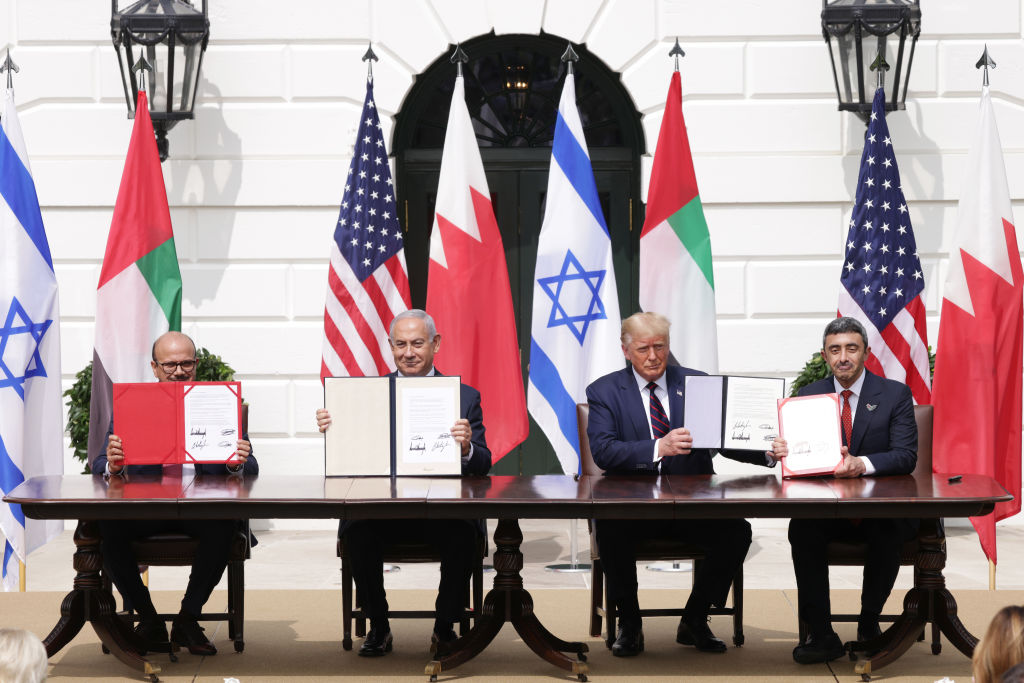 WASHINGTON, DC - SEPTEMBER 15: (L-R) Foreign Affairs Minister of Bahrain Abdullatif bin Rashid Al Zayani, Prime Minister of Israel Benjamin Netanyahu, U.S. President Donald Trump, and Foreign Affairs Minister of the United Arab Emirates Abdullah bin Zayed bin Sultan Al Nahyan participate in the signing ceremony of the Abraham Accords on the South Lawn of the White House September 15, 2020 in Washington, DC. Witnessed by President Trump, Prime Minister Netanyahu signed a peace deal with the UAE and a declaration of intent to make peace with Bahrain. (Photo by Alex Wong/Getty Images)