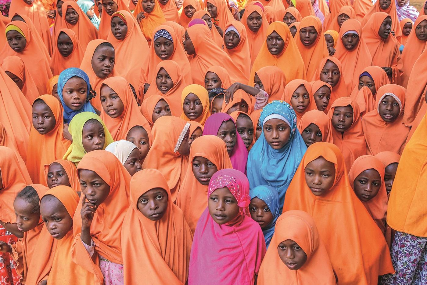 ZANZIBAR, TANZANIA - SEPTEMBER 14: Tanzanians wait to welcome as volunteers of