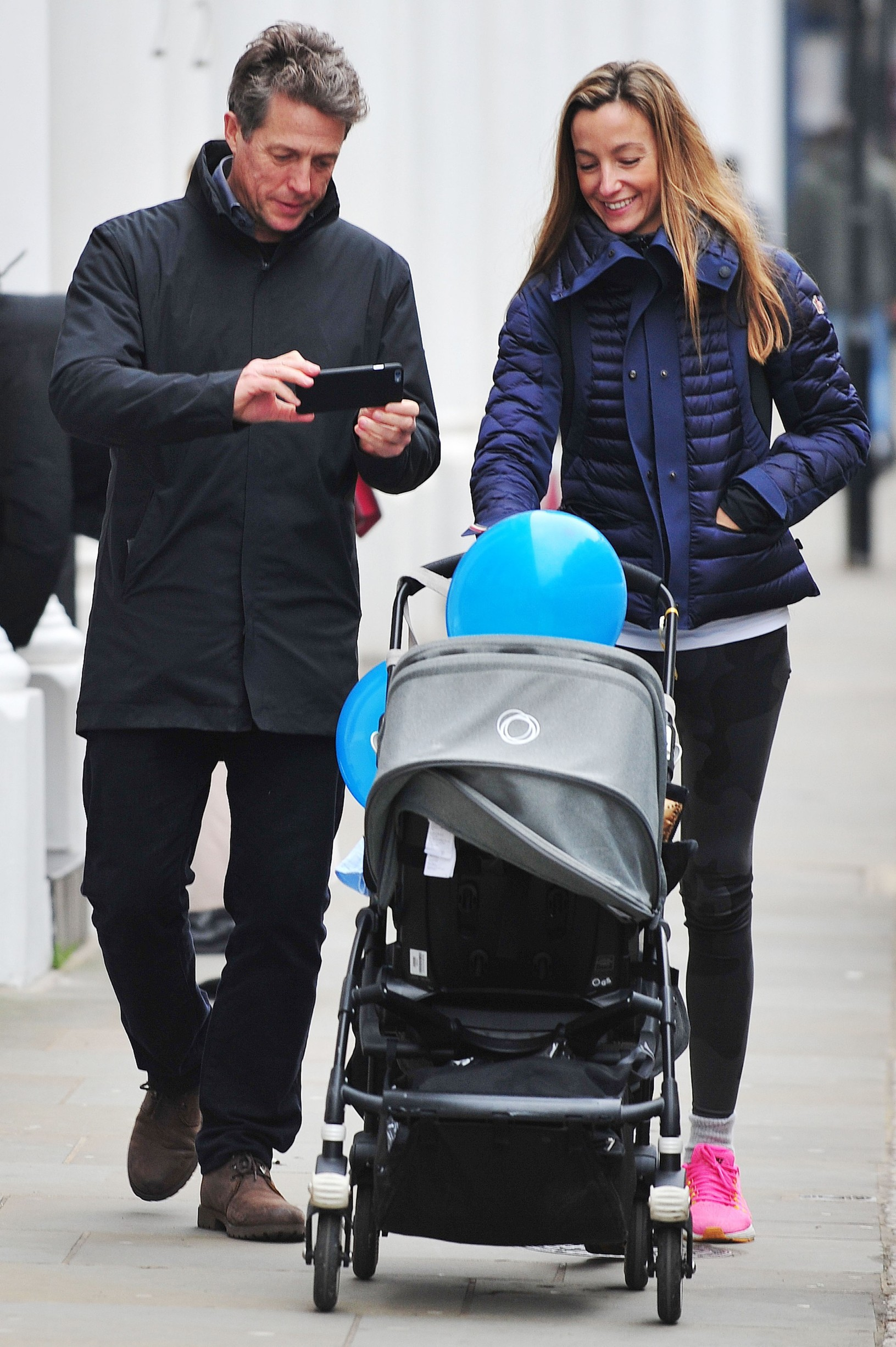 LONDON  - UK  *** PREMIUM EXCLUSIVE - MUST CALL FOR PRICING ***  **Pictures Taken 2nd DEC 2016*  British Actor Hugh Grant and Anna Eberstein are all smiles as they are pictured taking a stroll together with thier baby in Chelsea, West London.,Image: 307593396, License: Rights-managed, Restrictions: *** PREMIUM EXCLUSIVE - MUST CALL FOR PRICING *** -  PLEASE CREDIT AS PER BYLINE *UK CLIENTS - PLEASE PIXELATE CHILDS FACE BEFORE PUBLICATION***UK CLIENTS MUST CALL PRIOR TO TV OR ONLINE USAGE PLEASE CALL 0208 344 2007, Model Release: no, Credit line: DE74 / Backgrid UK / Profimedia