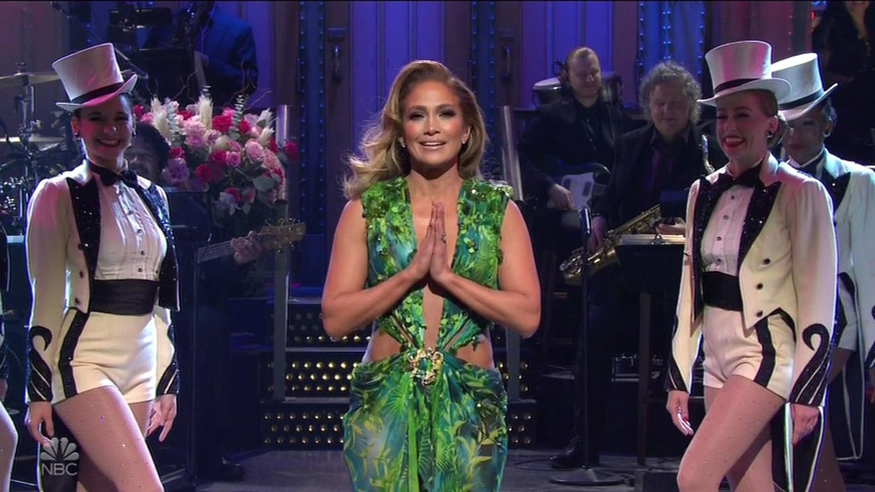 """Los Angeles, CA  - Jennifer Lopez kicks of Saturday Night Live in THAT sexy green Versace dress. J-Lo took to the main SNL stage for her monologue  to chat about the Christmas season — while dressed in a tuxedo. She told viewers she had a great year to be sure - reminding everyone she got engaged A-Rod, had a great tour - and will perform in the Super Bowl halftime show in a few months. """"I got what every girl from the Bronx dreams of: proposed to by a Yankee,"""