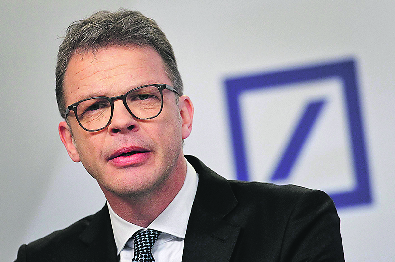 (FILES) In this file photo taken on January 30, 2020 Christian Sewing, CEO of German company Deutsche Bank, addresses journalists at the group's headquarters in Frankfurt am Main, western Germany. - Sewing warned that government stimuluses to combat the coronavirus pandemic may lead to