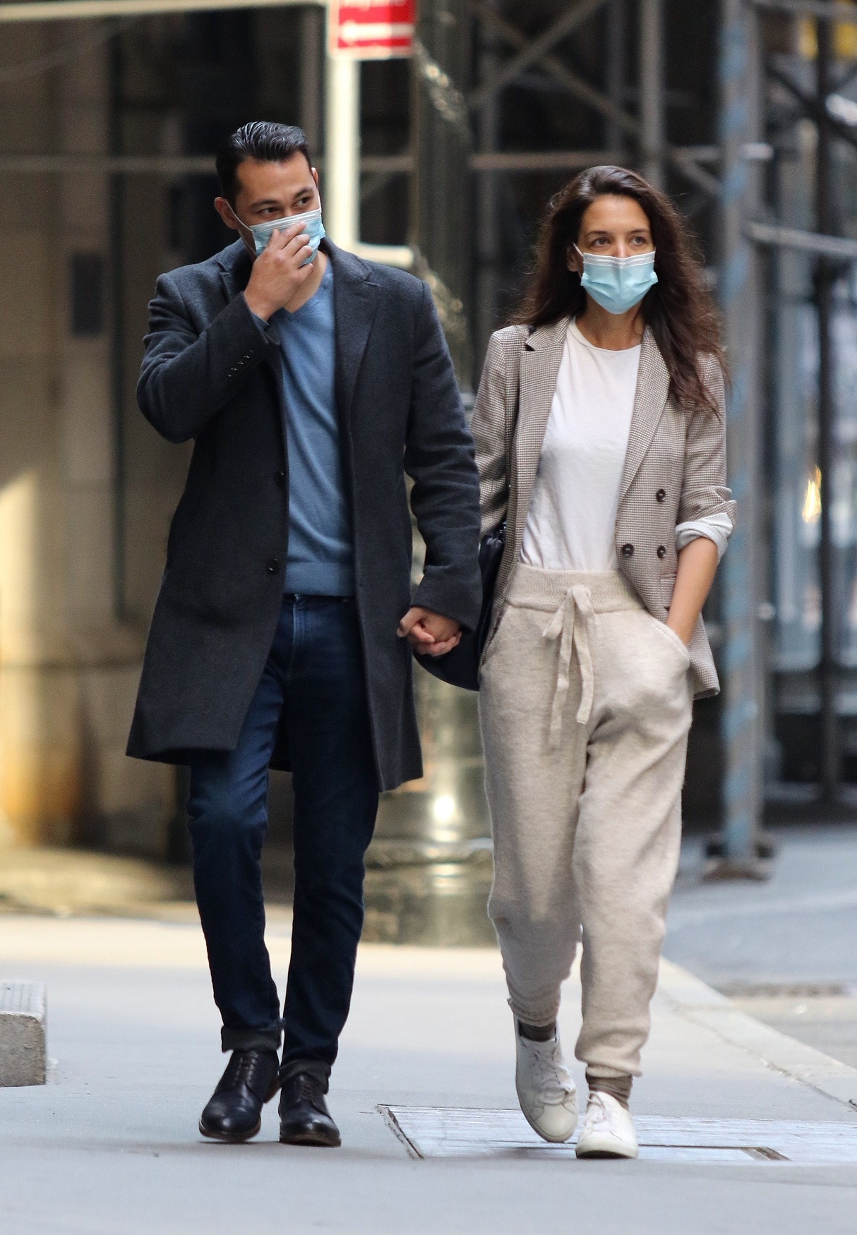 New York, NY  - Katie Holmes and boyfriend Emilio Vitolo Jr. are seen walking hand-in-hand after taking a ride in his red Pontiac from Katie's Soho apartment all the way to Downtown's Wall Street area. Emilio arrived at Katie's apt to pick her up, but first Katie invited her Chef boyfriend to her apt where the couple spent half hour inside before going for a joyride in his red Pontiac. The Chef was a gentleman as Katie patiently waited for him to open the car door for her. The new couple were all smiles as they spent the day touring New York City.  BACKGRID USA 21 SEPTEMBER 2020,Image: 559111958, License: Rights-managed, Restrictions: , Model Release: no, Credit line: BrosNYC / BACKGRID / Backgrid USA / Profimedia