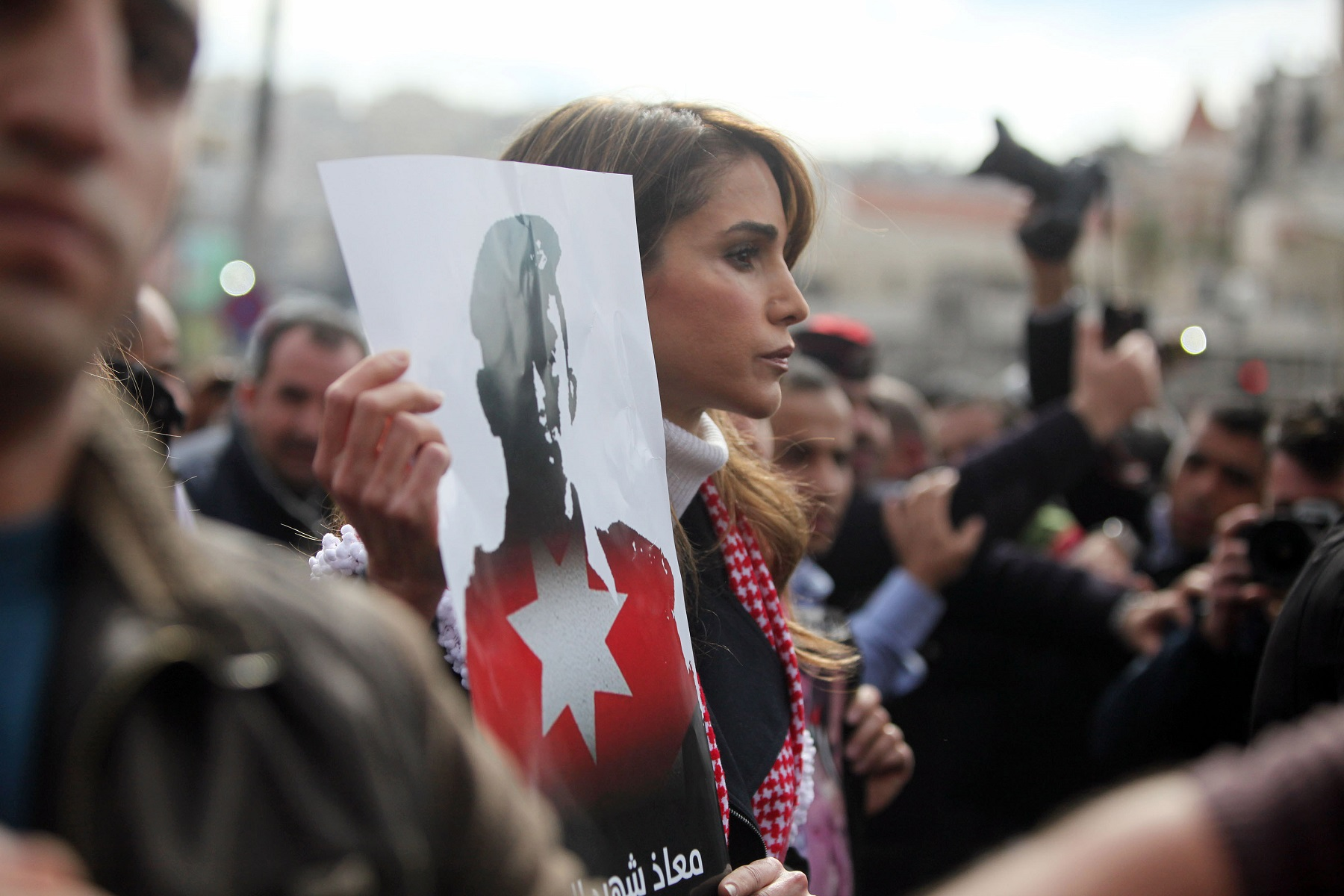 AMMAN, JORDAN- FEBRUARY 06:  Queen Rania of Jordan participates in a mass demonstration after Friday prayers near Al Hussein Mosque to express her solidarity with the pilot murdered by the Islamic State (IS) group earlier this week, on February 6, 2015 in Amman, Jordan. Muath al-Kasaesbeh was captured by the terror group after crashing his plane near Raqqa in northern Syria, during a mission against IS in December. (Photo by Jordan Pix/ Getty Images)