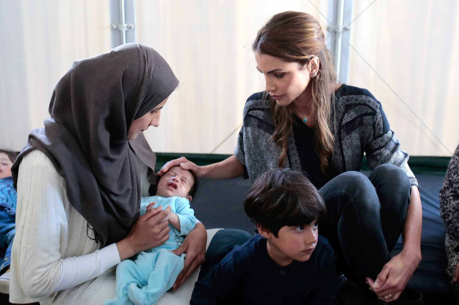 MYTILENE, GREECE - APRIl 25:  Queen Rania of Jordan meets Syrian refuges at the Karatepe municipality camp for refugees on the outskirts of Mytilene, on April 25, 2016 in Lesbos, Greece. Queen Rania has travelled to Lesbos at the invitation of the International Rescue Committee (IRC), her visit coming just over a week after that of Pope Francis. (Photo by Milos Bicanski/Getty Images)