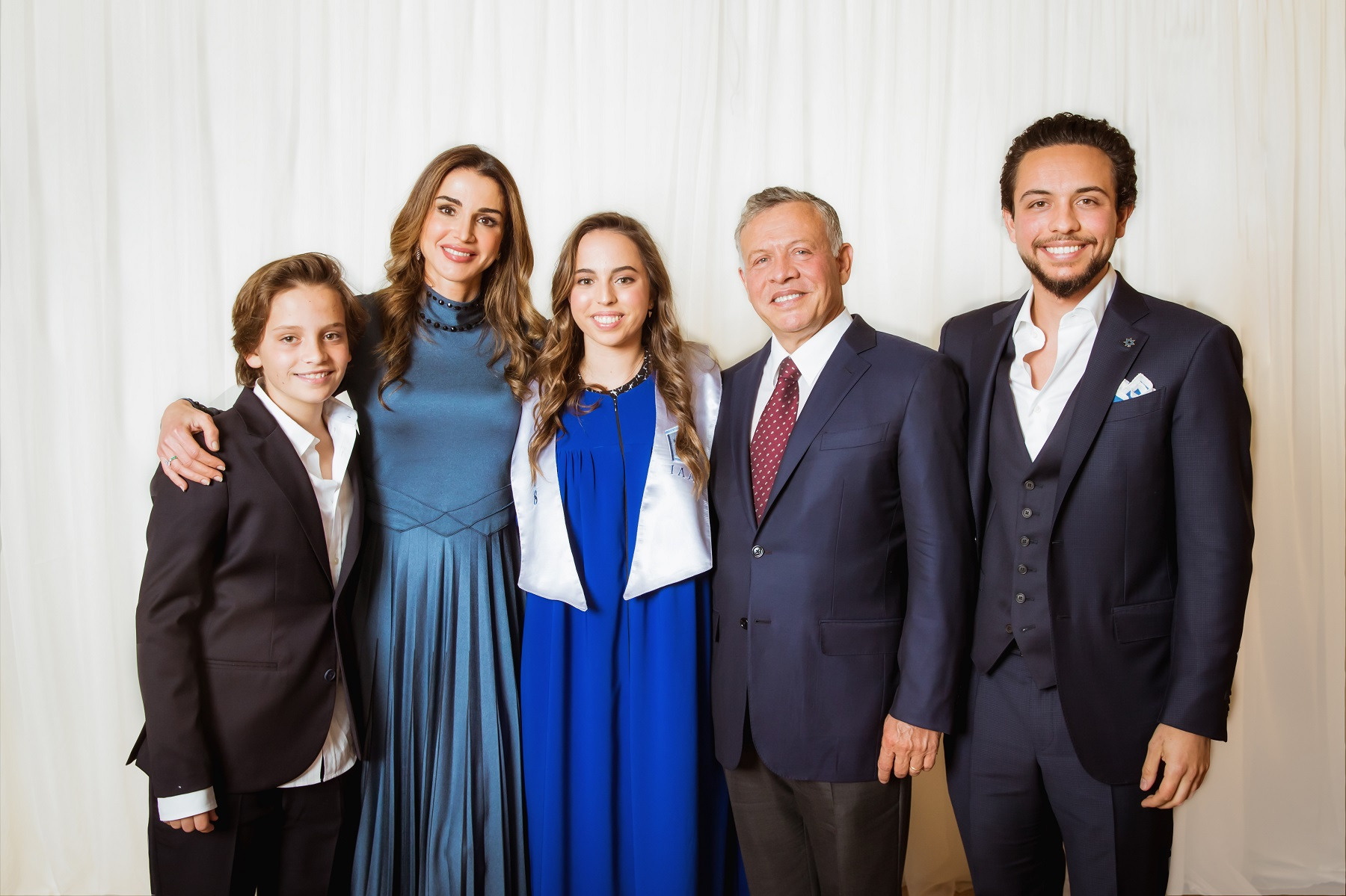 AMMAN, JORDAN- MAY 22: In this handout image provided by the Royal Hashemite Court,  Jordan's King Abdullah II (2nd-R), his wife Queen Rania and (2nd-L), Crown Prince Al Hussein (R) and Prince Hashem (L) attend the graduation ceremony of Princess Salma (C) from the International Academy on May 22, 2018 at Amman, Jordan. (Photo by Handout/Royal Hashemite Court via Getty Images)
