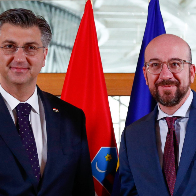 President of the European Council Charles Michel (R) welcomes Croatia's Prime Minister Andrej Plenkovic