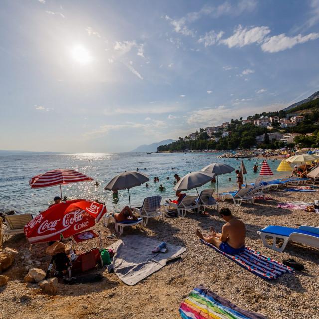 Ilustracija, turisti na plaži