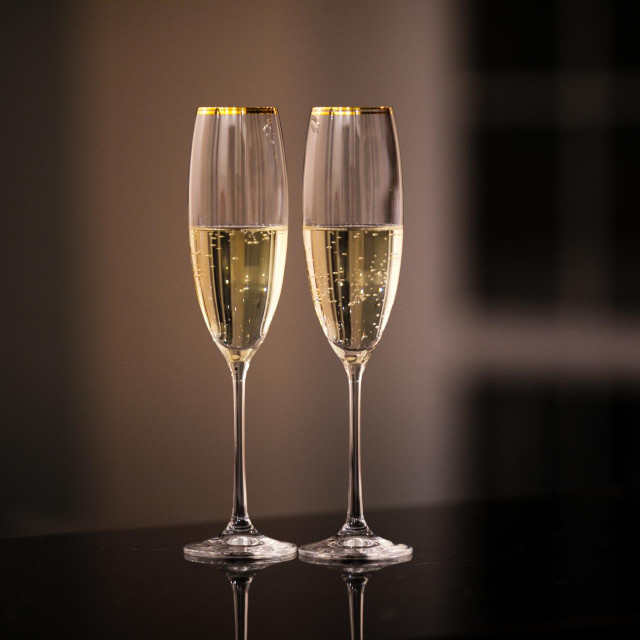 An elegant pair of glasses of champagne in the interior. Dining and night life concept.