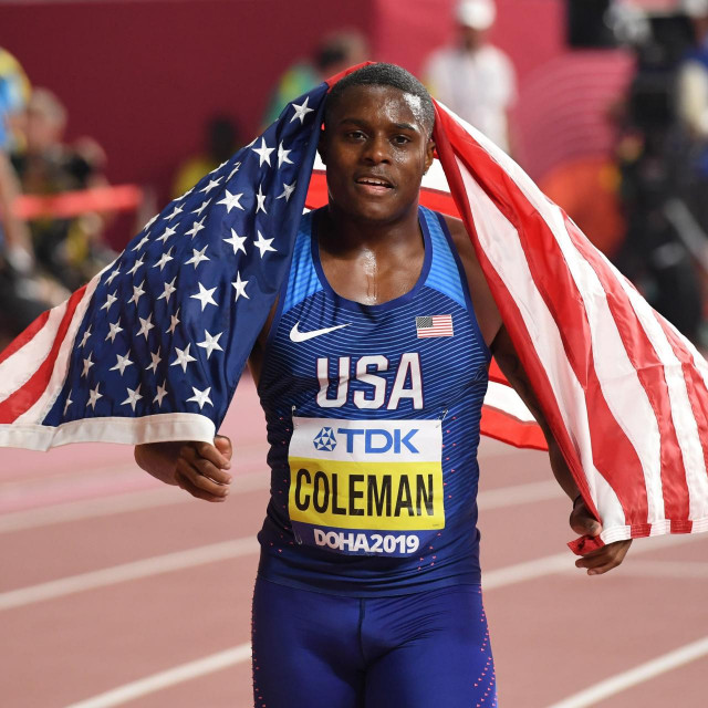 (FILES) This file photo taken on September 28, 2019 shows Christian Coleman of the US reacting after winning the men's 100m final at the 2019 IAAF World Athletics Championships at the Khalifa International stadium in Doha. - Reigning world 100m champion Christian Coleman was provisionally suspended on June 17, 2020 after missing a doping test, the Athletics Integrity Unit said. (Photo by Kirill KUDRYAVTSEV/AFP)