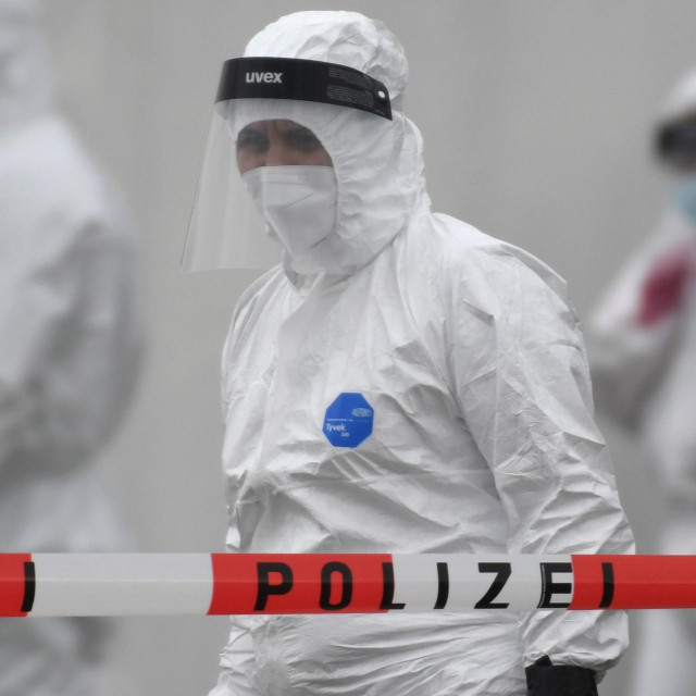 "TOPSHOT - Members of a coronavirus testing station stand on the factory premises of the Westfleisch meat processing company in Hamm, western Germany, on May 10, 2020, as all workers of the company have to be tested on the novel coronavirus after a spike in cases at their slaughterhouse. - Local authorities in the western federal state of North Rhine-Westphalia announced on May 8, 2020 that reopening plans were postponed and an ""emergency mechanism"" would come into effect due to high infection rates in the region. Many of the Westfleisch company's workers, partially originating from Eastern Europe and housed in shared accomodation, were tested positive on the novel coronavirus that can cause the COVID-19 disease. (Photo by Ina FASSBENDER/AFP)"