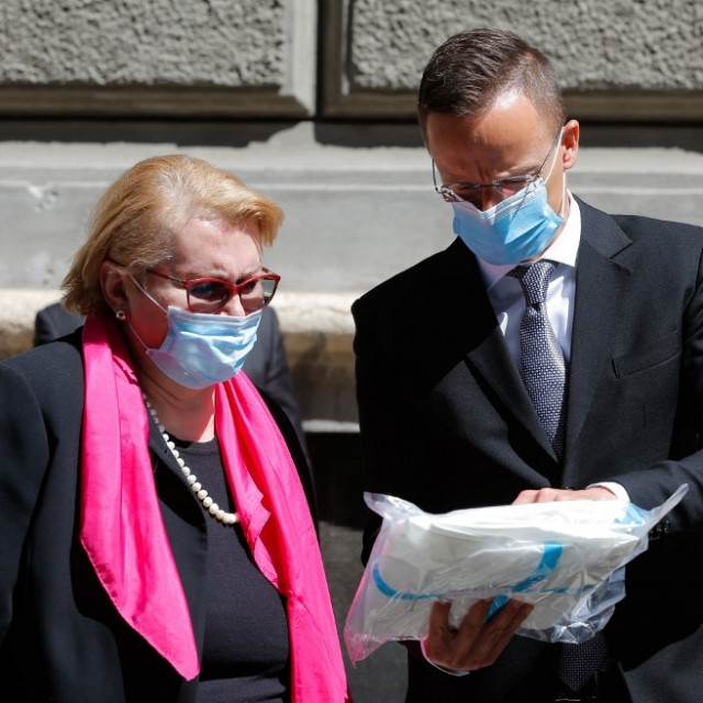 Hungarian Minister of Foreign Affairs and Trade Peter Szijjarto (R) delivers medical equipment aid to Bosnian Foreign Minister Bisera Turkovic (L) within the coronavirus (Covid-19) precautions in Sarajevo, Bosnia and Herzegovina on April 16,
