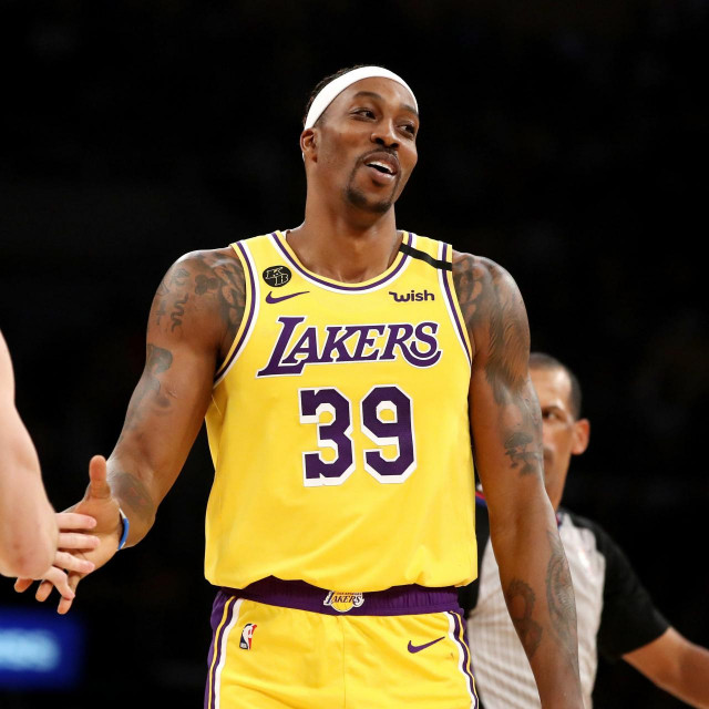 LOS ANGELES, CALIFORNIA - FEBRUARY 25: Dwight Howard #39 and Alex Caruso #4 of the Los Angeles Lakers reacts to a play in a game against the New Orleans Pelicans during the second half at Staples Center on February 25, 2020 in Los Angeles, California. NOTE TO USER: User expressly acknowledges and agrees that, by downloading and or using this Photograph, user is consenting to the terms and conditions of the Getty Images License Agreement. Katelyn Mulcahy/Getty Images/AFP<br /> == FOR NEWSPAPERS, INTERNET, TELCOS & TELEVISION USE ONLY ==