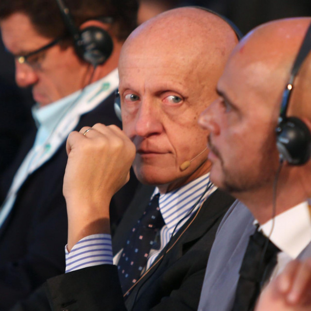 Italian former football referee Pierluigi Collina (C) attends the first session of the eighth Dubai International Sports Conference on December 28, 2013 in Dubai. AFP PHOTO/MARWAN NAAMANI