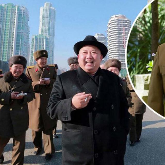 Kim Jong-un (u sredini), Alejandro Cao of Benos (u krugu)