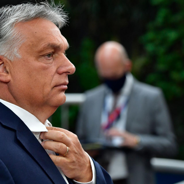 "Hungary's Prime Minister Viktor Orban arrives for the EU summit on a coronavirus recovery package at the European Council building in Brussels on July 19, 2020 - An acrimonious EU summit headed into a third day as leaders remained deadlocked over a huge post-coronavirus economic recovery plan, unable to overcome fierce resistance from the Netherlands and its ""frugal"" allies. (Photo by JOHN THYS/POOL/AFP)"