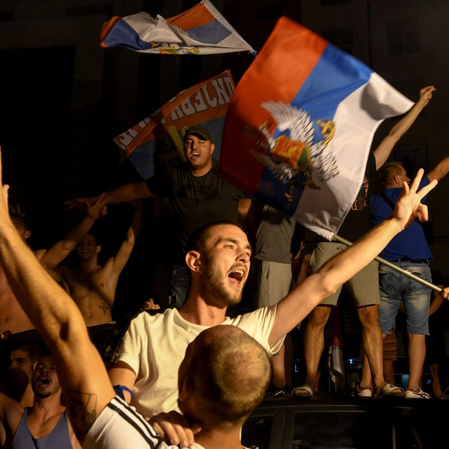 Opposition supporters celebrate on the streets after the general elections in Podgorica, early hours on August 31, 2020. - Montenegro's ruling party was a hair ahead of the main pro-Serb opposition alliance in a hotly-fought election on August 30 that left both sides without a full majority, a preliminary exit poll showed, portending uncertain coalition talks for the Adriatic nation. With little over a third of the vote share, the Democratic Party of Socialists (DPS) led by President Milo Djukanovic -- in power for some three decades -- looked set for its worst electoral showing in history. (Photo by SAVO PRELEVIC/AFP)