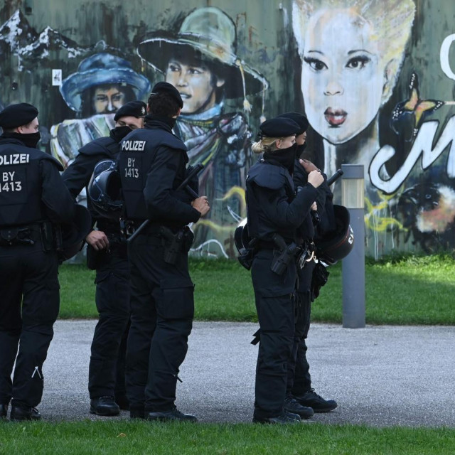 Police officers wait next to a demonstration against the coronavirus Covid-19 restrictions in Munich, southern Germany, on September 12, 2020. (Photo by Christof STACHE/AFP)