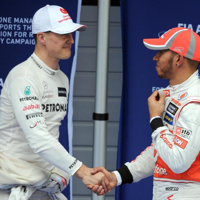 Michael Schumacher i Lewis Hamilton u travnju 2012. godine