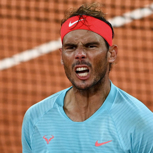Spain's Rafael Nadal celebrates after winning against Italy's Jannik Sinner at the end of their men's singles quarter-final tennis match on Day 10 of The Roland Garros 2020 French Open tennis tournament in Paris on October 6, 2020. (Photo by Anne-Christine POUJOULAT/AFP)