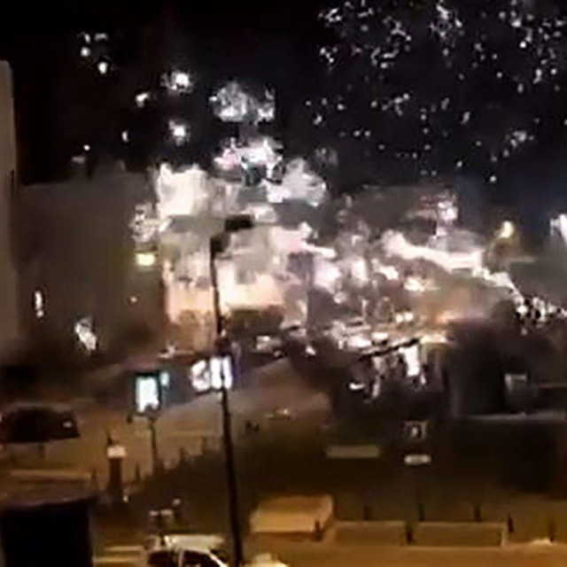 "This handout image grab made from a video posted on the Twitter account of @LeCapricieux94 shows fireworks exploding outside the police station of Champigny-sur-Marne, outside Paris, in the night of October 10 to 11, 2020, as it is attacked by around 40 people launching fireworks. - Around 40 people staged an hour-long fireworks attack against a police station outside around 12 kilometres (8 miles) east of the French capital early on October 11, authorities said, the latest in a string of incidents targeting security forces in recent months. The station's entrance and several police vehicles were damaged but nobody was injured during the raid launched just before midnight. (Photo by various sources/AFP)/RESTRICTED TO EDITORIAL USE - MANDATORY CREDIT ""AFP PHOTO/Twitter account of @LeCapricieux94"" - NO MARKETING NO ADVERTISING CAMPAIGNS - DISTRIBUTED AS A SERVICE TO CLIENTS"