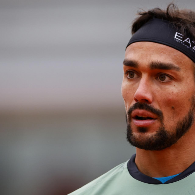 Italy's Fabio Fognini reacts as he plays against Kazakhstan's Mikhail Kukushkin during their men's singles first round tennis match at the Simonne Mathieu court on Day 2 of The Roland Garros 2020 French Open tennis tournament in Paris on September 28, 2020. (Photo by Thomas SAMSON/AFP)