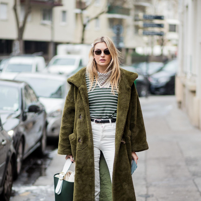 PARIS, FRANCE - MARCH 01: Camille Charriere wearing green teddy coat is seen outside Carven on March 1, 2018 in Paris, France. (Photo by Christian Vierig/Getty Images)
