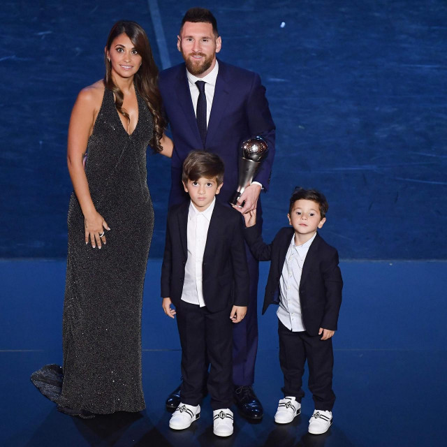 "(FILES) In this file photo taken on September 23, 2019 Best FIFA Men's Player of 2019, Argentina and Barcelona forward Lionel Messi poses with his wife Antonella Roccuzzo Messi and their children at the end of The Best FIFA Football Awards ceremony in Milan. - Six-time Ballon d'Or winner Lionel Messi told Barcelona he wants to leave -- on a free transfer -- in a ""bombshell"" fax yesterday that is expected to spark a legal battle over a buy-out clause worth hundreds of millions of dollars. (Photo by Marco Bertorello/POOL/AFP)"
