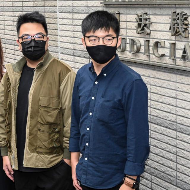 Joshua Wong (desno) i drugi okrivljeni u procesu