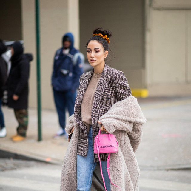 NEW YORK, NEW YORK - FEBRUARY 11: Tamara Kalinic is seen wearing plaid blazer, pink Balenciaga bag, denim jeans, sneaker outside Zadig & Voltaire during New York Fashion Week Autumn Winter 2019 on February 11, 2019 in New York City. (Photo by Christian Vierig/Getty Images)
