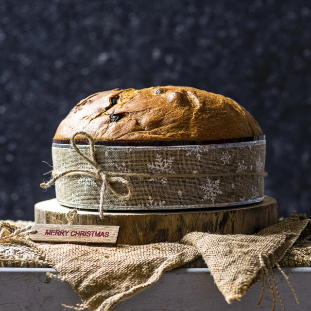 Isolated panettone, typical christmas italian food, on rustic rusticbackground.