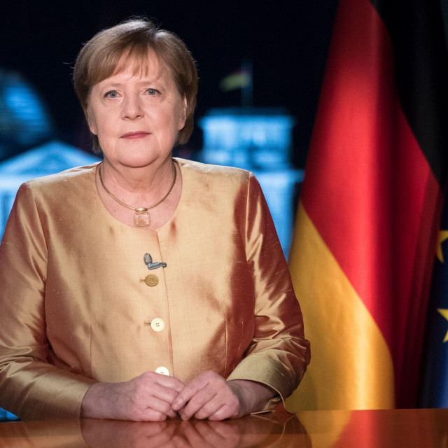 ATTENTION EDITORS � PICTURE EMBARGOED FOR PUBLICATION UNTIL DECEMBER 31, 2020 AT 00:00 AM CET - FREE FOR THURSDAY DECEMBER 31, 2020 NEWSPAPERS - German Chancellor Angela Merkel poses for photographs after the television recording of her annual New Year's speech at the chancellery in Berlin, Germany, on December 30, 2020. (Photo by Markus Schreiber/POOL/AFP)