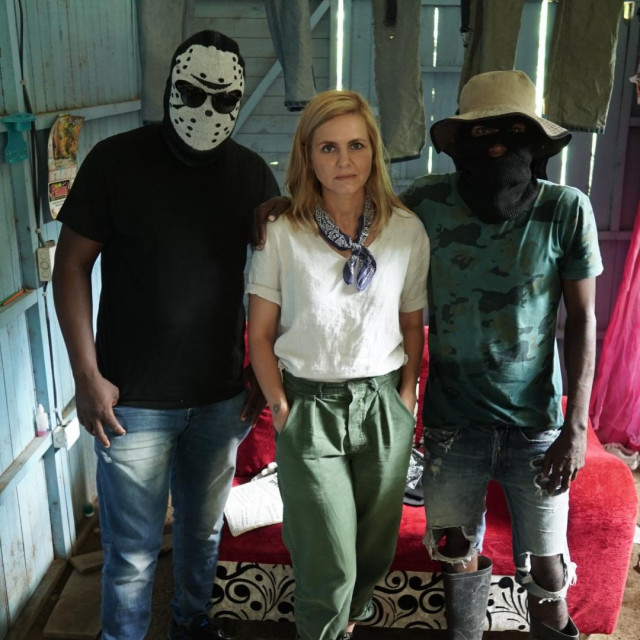 Turbo, Columbia - Mariana van Zeller (center) with two men from Clan Del Golfo. (National Geographic/Muck Media)