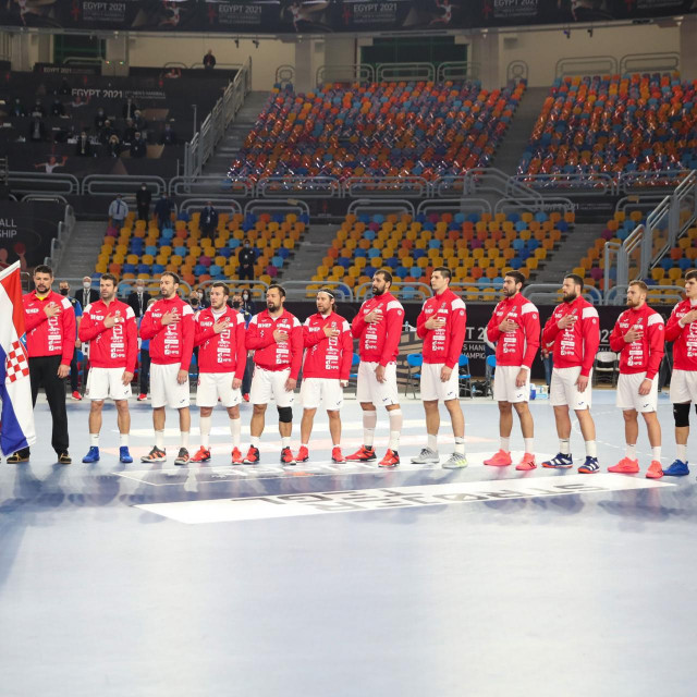 Croatia's players listen to their national anthem ahead of the 2021 World Men's Handball Championship match between Group II teams Denmark and Croatia at the Cairo Stadium Sports Hall in the Egyptian capital on January 25, 2021. (Photo by MOHAMED ABD EL GHANY/POOL/AFP)