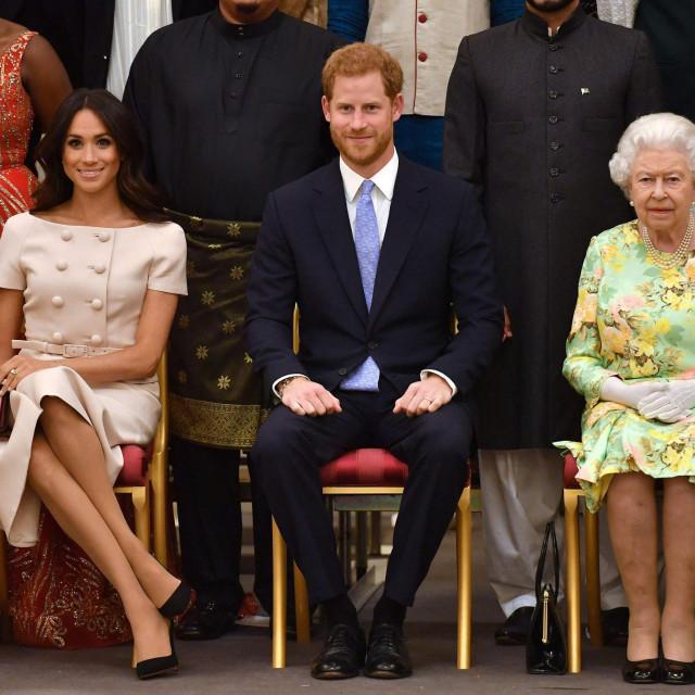 Meghan Markle, princ Harry i britanska kraljica