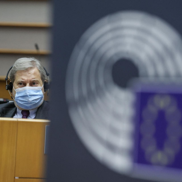 EU Commissioner for Budget Johannes Hahn looks on during the debate on the application of Regulation (EC) 2020/2092, the Rule of Law conditionality mechanism during a plenary session of The European Parliament in Brussels on March 11, 2021. (Photo by Aris Oikonomou/POOL/AFP)