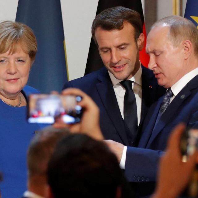 Angela Merkel, Emmanuel Macron i Vladimir Putin