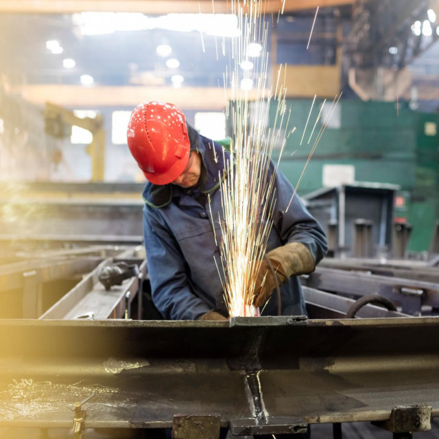 Radnik u američkoj tvornici, ilustracija