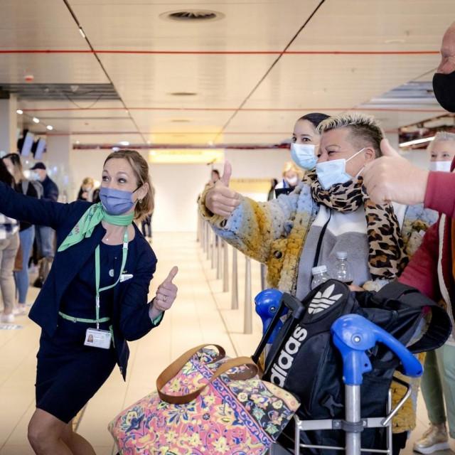 Odlazak turista iz zračne luke Schipol u Nizozemskoj