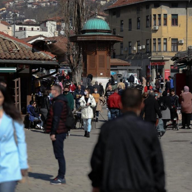 SARAJEVO, BOSNIA AND HERZEGOVINA - MARCH 05: People are seen at streets without social distance as the density of people in the city center increases with the warming of the weather in Sarajevo, Bosnia and Herzegovina on March 05, 2021.In Bosnia and Herzegovina, where mass vaccination against coronavirus (Covid-19) has not started yet and has difficulties in vaccine supply, the number of cases has started to increase again in recent days. Elman Omic/Anadolu Agency (Photo by Elman Omic/ANADOLU AGENCY/Anadolu Agency via AFP)