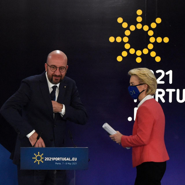 President of the European Council Charles Michel and European Commission President Ursula von der Leyen arrive to give a press conference during the European Social Summit hosted by the Portuguese presidency of the Council of the European Union at the Palacio de Cristal in Porto on May 8, 2021. (Photo by MIGUEL RIOPA/AFP)