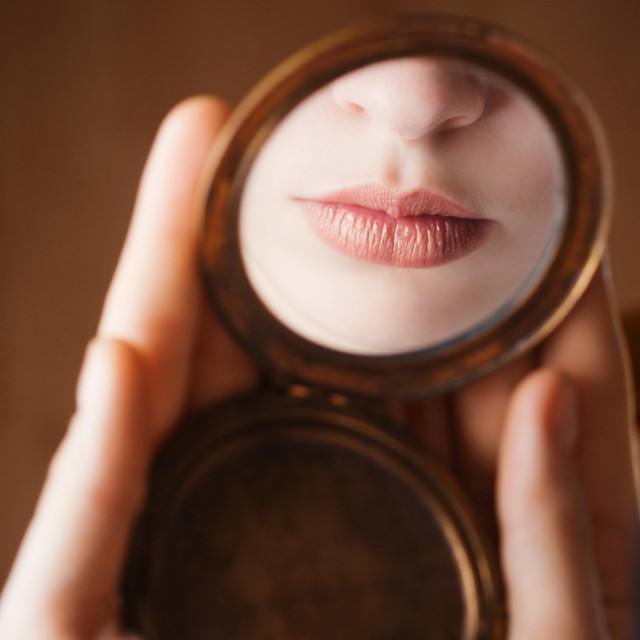 Girl lips in reflecting in a mirror