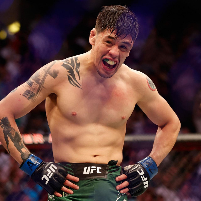 GLENDALE, ARIZONA - JUNE 12: Brandon Moreno of Mexico celebrates after defeating Deiveson Figueiredo of Brazil to win the flyweight championship during their UFC 263 match at Gila River Arena on June 12, 2021 in Glendale, Arizona.<br /> == FOR NEWSPAPERS, INTERNET, TELCOS & TELEVISION USE ONLY ==