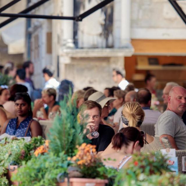 Split, Croatia - August 19, 2017: People sit and enjoy their meal in some street restaurant.